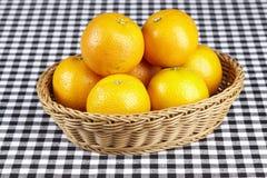 Korg av apelsiner Royaltyfria Foton