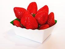 Korg av jordgubbar Arkivfoto