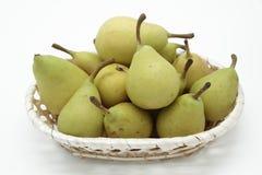 Korg av pears Arkivfoton