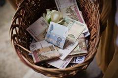 Korg av pengar Arkivbild