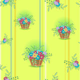 Korg med blommaguling Arkivfoton