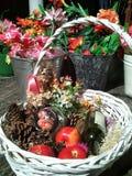 korg med blommor och äpplen royaltyfria foton