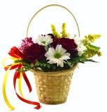 Korg med blommor på en vit bakgrund Royaltyfria Bilder