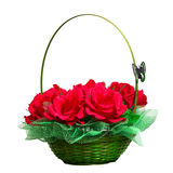 Korg med konstgjorda rosor Fotografering för Bildbyråer