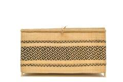 Korg som göras från bambu på en vit bakgrund med den snabba banan Royaltyfria Foton