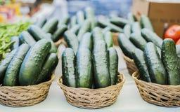Korgar av gurkor Fotografering för Bildbyråer