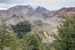 Korkade berg för snö Arkivbilder