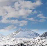 Korkade berg för snö Arkivfoton
