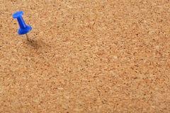 Korkenvorstand mit blauem Stift Stockfotos