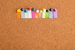 Korkowa deska i kolorowy kłoszenie dla jedenaście listowego słowa Fotografia Royalty Free