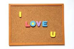 Korkowa deska z kocham ciebie sformułowania Zdjęcie Stock