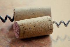 Korkskruv två med vinkorkar Närbild Royaltyfri Bild