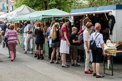 KORNELIMUENSTER, GERMANY, 18th June, 2017 - People browse the historic fair of Kornelimuenster on a sunny warm day. Stock Images