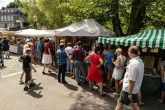 KORNELIMUENSTER, GERMANY, 18th June, 2017 - People browse the historic fair of Kornelimuenster on a sunny warm day. Stock Image