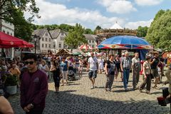 KORNELIMUENSTER, GERMANY, 18th June, 2017 - People browse the historic fair of Kornelimuenster on a sunny warm day. Stock Photos