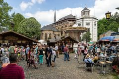 KORNELIMUENSTER, GERMANY, 18th June, 2017 - People browse the historic fair of Kornelimuenster on a sunny warm day. Royalty Free Stock Photo