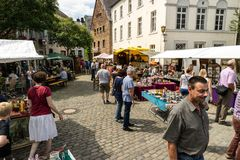 KORNELIMUENSTER, GERMANY, 18th June, 2017 - People browse the historic fair of Kornelimuenster on a sunny warm day. Royalty Free Stock Images