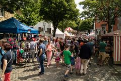 KORNELIMUENSTER, GERMANY, 18th June, 2017 - People browse the historic fair of Kornelimuenster on a sunny warm day. Stock Photography