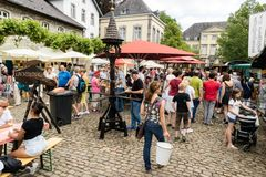 KORNELIMUENSTER, GERMANY, 18th June, 2017 - People browse the historic fair of Kornelimuenster on a sunny warm day. Royalty Free Stock Image
