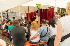 KORNELIMUENSTER, GERMANY, 18th June, 2017 - People watching a puppet theater on the historic fair of Kornelimuenster Stock Photography