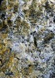 Kornig mineralisk yttersida Arkivbild