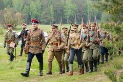 Kornilovs hiking squad. RUSSIA, CHERNOGOLOVKA - MAY 17: Unidentified people of Kornilovs hiking squad walk on History reenactment of battle of Civil War in 1914 Stock Image