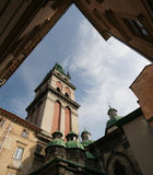 Kornyakt bell tower, church of Assumption. Church of Assumption and Kornyakt bell tower in Lviv Royalty Free Stock Photography