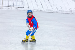 KOROLEV, RUSSIA - MARCH 8, 2016: Young boy during ice hockey training at open air Vympel stadium Royalty Free Stock Photo