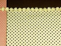 Koronka z pomarańczowym i brown polek kropek tłem Obraz Stock
