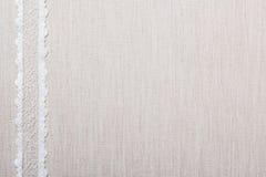 Koronkowy faborek na bieliźnianego płótna tle Fotografia Stock