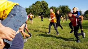 KOROSTEN - AUG, 12, 2019: boys and girls youth teenage christian camps play teambuilding in sunny day. outdoor