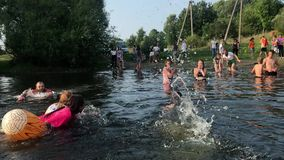KOROSTEN - AUG, 12, 2019: youth teenage christian camp and active water games. swimming in the river. cardboard ship stock footage