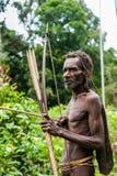 Korowai kombai (Kolufo) with bow and arrows Royalty Free Stock Image