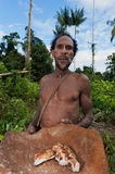 Korowai Kombai ( Kolufo) man  with saga worms Stock Photography