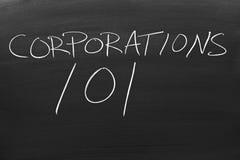 Korporacje 101 Na Blackboard zdjęcia royalty free