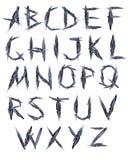Korpsvart fjäder för alfabet Arkivbild