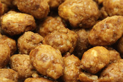 Korrel geroosterde pinda's in karamelglans royalty-vrije stock afbeelding