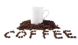 Korrels van koffie met een witte kop Stock Fotografie