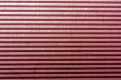 Korrugerad röd tonad yttersida för metallplatta Royaltyfri Fotografi