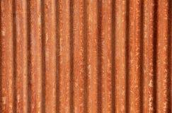 Korrugerad rostad stålbakgrund Fotografering för Bildbyråer