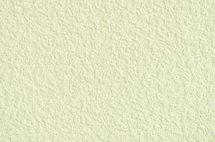 Korrugerad textur av ett ljus - gul vägg Royaltyfri Foto