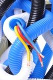 Korrugerade rør med elektriska kablar Fotografering för Bildbyråer
