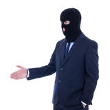 Korruptionbegrepp - man i affärsdräkt och svart maskering med mummel arkivbilder