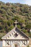 Kors av den romanska kyrkan Arkivfoton