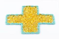 Kors av preventivpillerar och kapslar Royaltyfri Foto