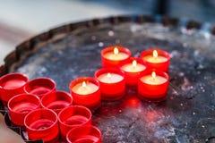 Kors av votive stearinljus Arkivfoton
