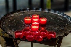 Kors av votive stearinljus Royaltyfri Foto