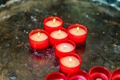 Kors av votive stearinljus Fotografering för Bildbyråer