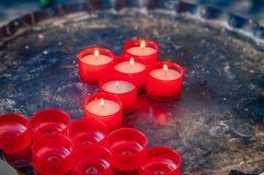 Kors av votive stearinljus Royaltyfri Bild