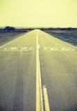 Kors bearbetad gammal filmstil Route 66 Arkivfoto